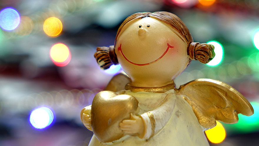 Christmas tree decoration of a little angel smiling.