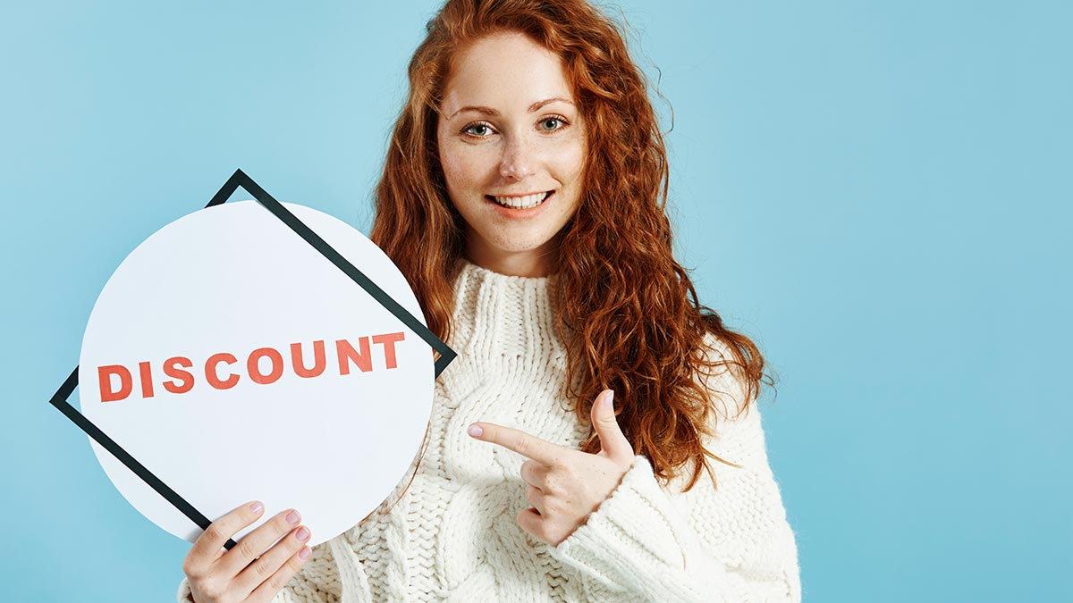 woman-holding-a-discount-banner