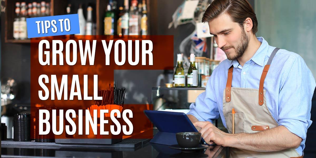 Young restaurant entrepreneur reviewing business metrics.